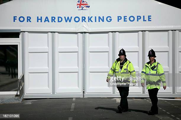 Police officers patrol the perimeter of Manchester Central the venue for the 2013 annual Conservative Party Conference on September 28 2013 in...