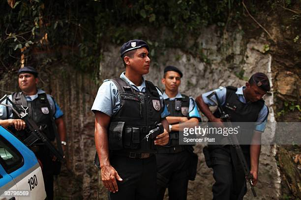 """Police officers patrol the recently """"pacified"""" Babilônia slum, or favela, on December 3, 2009 in Rio de Janeiro, Brazil. Babilônia is one of a number..."""