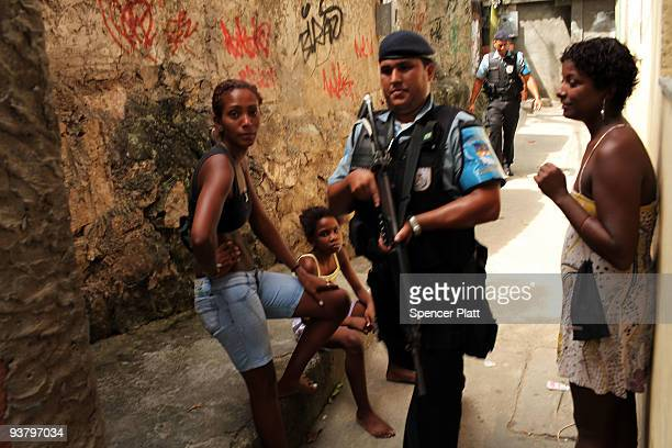 Police officers patrol the recently 'pacified' Babilônia slum or favela on December 3 2009 in Rio de Janeiro Brazil Babilônia is one of a number of...