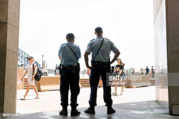 Police officers patrol the street in Sydney, copy space