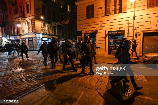 Police officers patrol the streets as protesters gather during an anti government demonstration on October 26 2020 in Turin Italy Following a surge...
