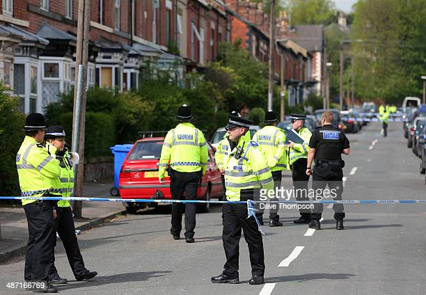 Police officers patrol Wake Road in Sheffield after 3 generations of the same family were killed in a house fire overnight on April 28, 2014 in...