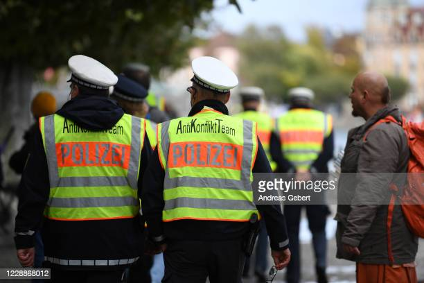 """Police officers patrol while supporters of the """"Querdenken"""" movement try to create Europe's biggest ever human chain on October 3, 2020 at Konstanz,..."""