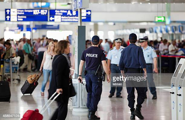 Police officers patrolling in Athens International Airport, Greece.