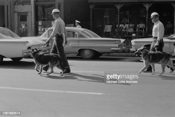 Police officers patrolling the streets at the start of the Birmingham Campaign in Birmingham, Alabama, May 1963. The movement, which called for the...