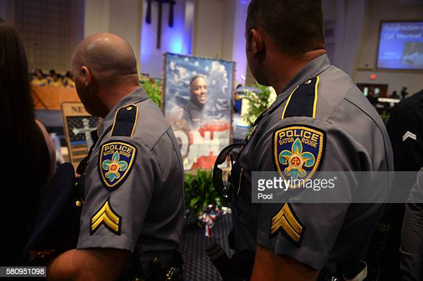 Police officers pay their respects during the funeral of Baton Rouge police corporal Montrell Jackson at the Living Faith Christian CenterJuly 25,...