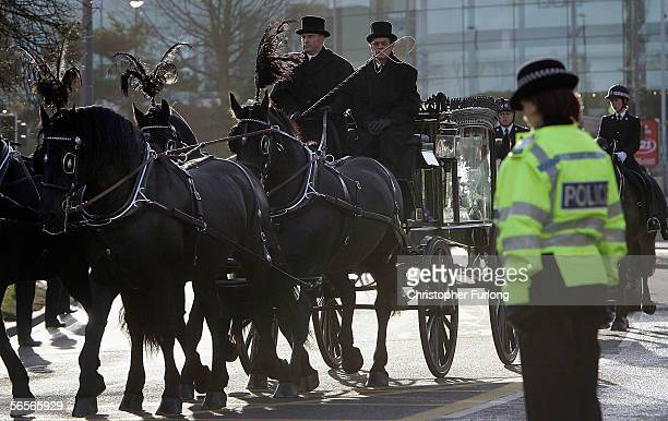 Police officers pay their respects to the funeral cortege of Police Constable Sharon Beshenivsky on January 11 2006 in Bradford England PC...