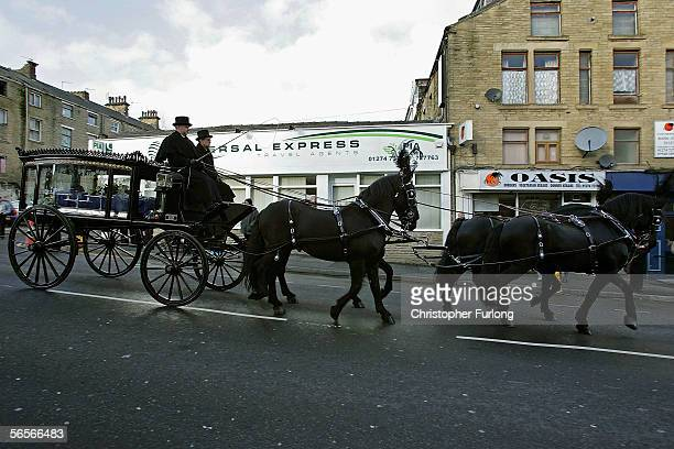 Police officers pay their respects to the funeral cortege of Police Constable Sharon Beshenivsky as it passes the scene of her murder in Morley...