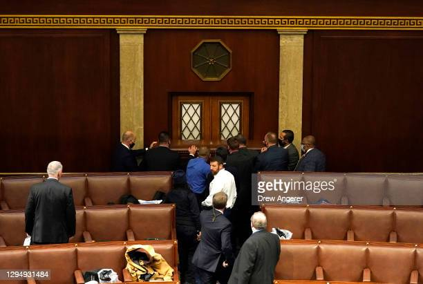 Police officers point attempt to barricade 2a door that was vandalized in the House Chamber during a joint session of Congress on January 06, 2021 in...