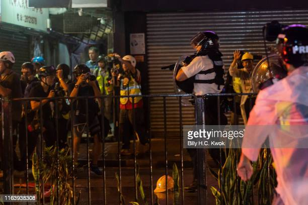 Police officers point their guns towards antiextradition bill protesters after a clash in Tsuen Wan on August 25 2019 in Hong Kong China Prodemocracy...