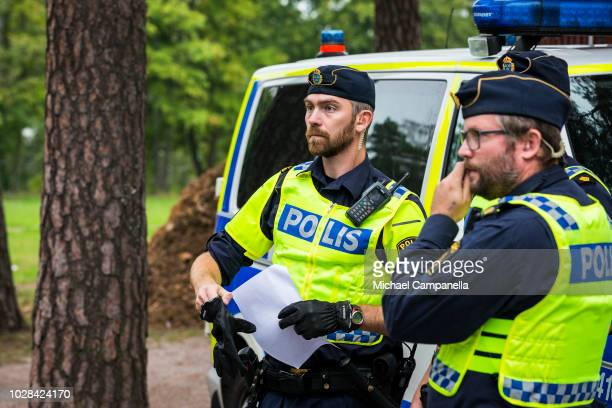 Police officers prepare for a political rally for the right wing Sweden Democrats party at Traffens Outdoors Theater ahead of the Swedish general...