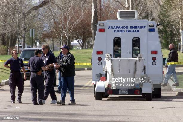 Police officers prepare to search for bombs in the Columbine High School area in Littleton, C0 21 April 1999. Authorities confirmed 21 April 1999...