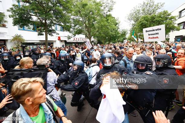Police officers prevent anti coronavirus vaccine protesters to march from Victory Column to Bundestag and Brandenburg Gate during a demonstration...