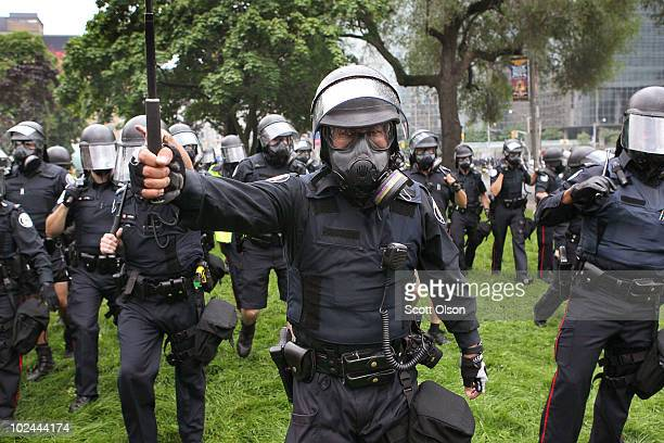 Police officers push back demonstrators protesting the G8/G20 summits on June 26, 2010 in Toronto, Ontario Canada. Store windows were smashed and a...