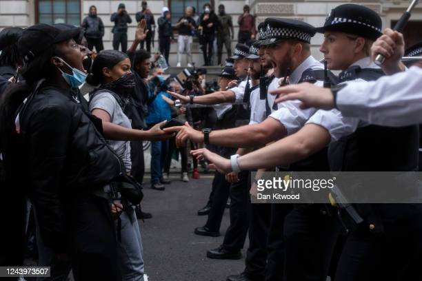 Police officers push demonstrators back during a Black Lives Matter protest on June 3 2020 in London United Kingdom The death of an AfricanAmerican...