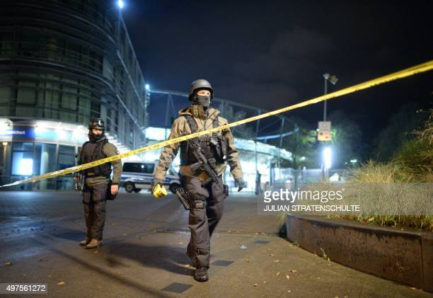 Police officers put a security tape outside the HDI Arena after the friendly football match Germany vs the Netherlands was called off for 'security...