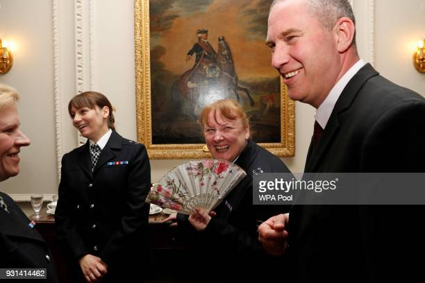 Police officers react as they attend a reception for the winners of The Met Excellence Awards at Kensington Palace on March 13 2018 in London England