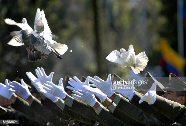 Police officers release doves in honour of their collegues being held hostage by FARC guerrillas during a ceremony where officers Alexis Torres Juan...