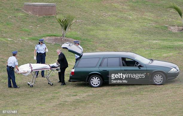 Police officers remove the body of a young man believed to be 19 years old found in Basque Park Newton on March 19 2006 in Auckland New Zealand