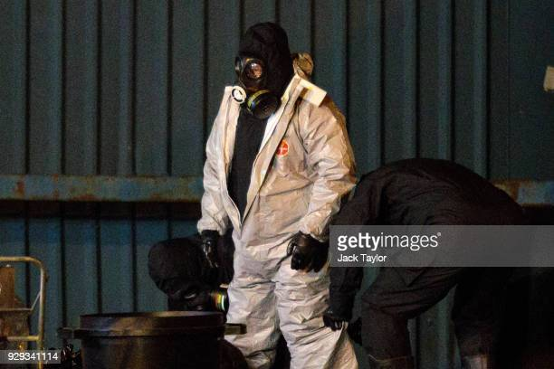 Police officers remove their protective suits on an industrial site as they continue investigations into the poisoning of Sergei Skripal in Salisbury...