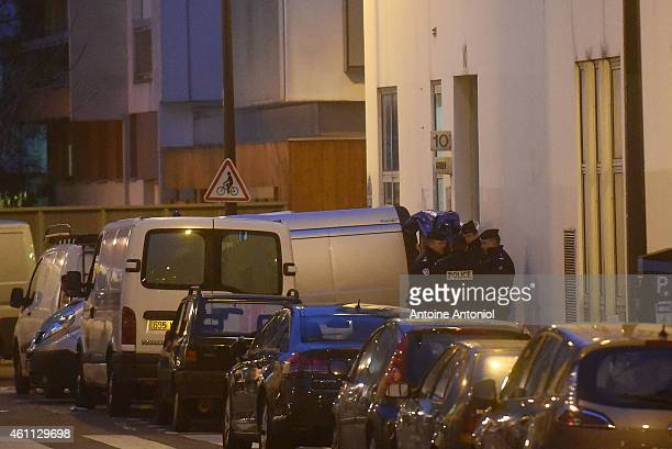 Police officers reportedly evacuate bodies from the offices of the French satirical newspaper Charlie Hebdo on Nicolas Appert Street on January 7...