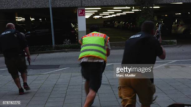 Police officers respond to the shooting at the Olympia Einkaufzentrum at July 22 2016 in Munich Germany According to reports several people have been...