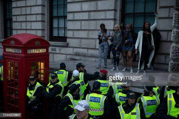 Police officers round up the last few demonstrators at the end of a Black Lives Matter protest on June 3, 2020 in London, United Kingdom. The death...