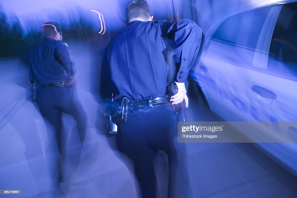 Police officers running : Stock Photo