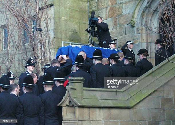 Police officers salute as the coffin of Police Constable Sharon Beshenivsky is carried into Bradford Cathedral on January 11 2006 in Bradford England...