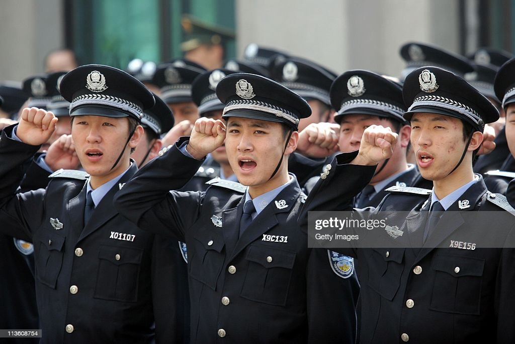 Police officers salute their national flag as China celebrates Youth Day on May 4, 2011 in Shenyang, Liaoning Province of China. The Youth Day in China falls on May 4 every year to commemorate the beginning of the May Fourth Movement (1919).