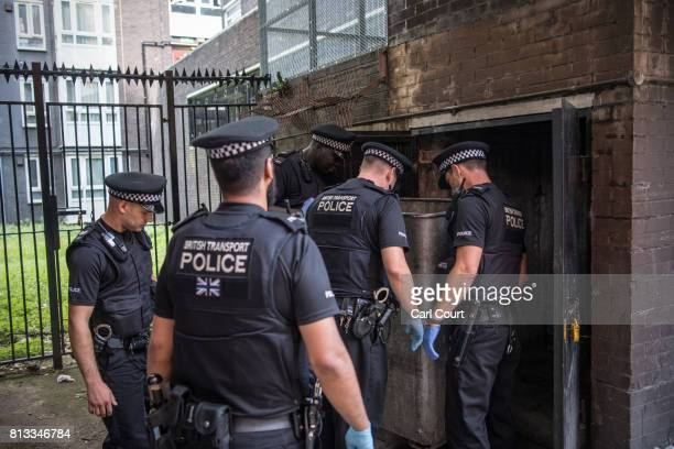 Police officers search a bin area after a knife was thrown by a suspect after he was apprehended near Elephant and Castle Station during Operation...