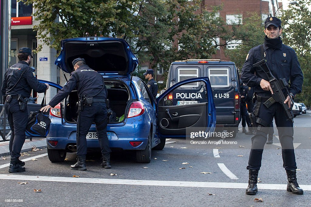 Police officers search a car outside the Estadio Santiago Bernabeu during security checks prior to the La Liga match between Real Madrid CF and FC Barcelona at Estadio Santiago Bernabeu on November 21, 2015 in Madrid, Spain.