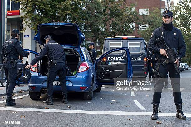 Police officers search a car outside the Estadio Santiago Bernabeu during security checks prior to the La Liga match between Real Madrid CF and FC...