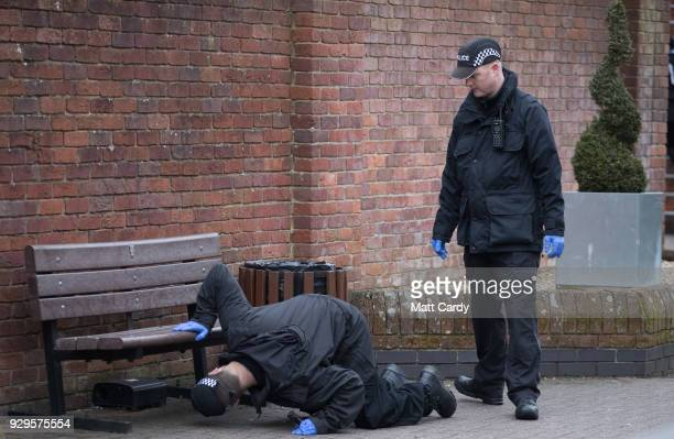 Police officers search ahead of the visit by Home Secretary Amber Rudd to the scene at the Maltings shopping centre in where former Russian double...