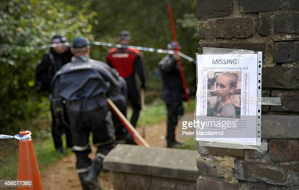 Police officers search an area next to the river Brent for clues in the hunt for schoolgirl Alice Gross on September 25 2014 in London England The...