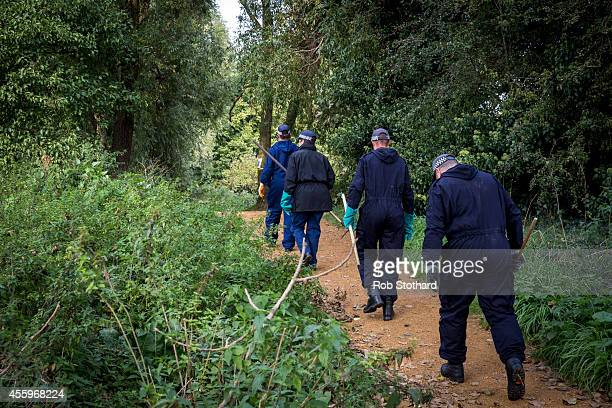 Police officers search an area of shrubland close to the bank of the River Brent where police are searching for missing schoolgirl Alice Gross on...