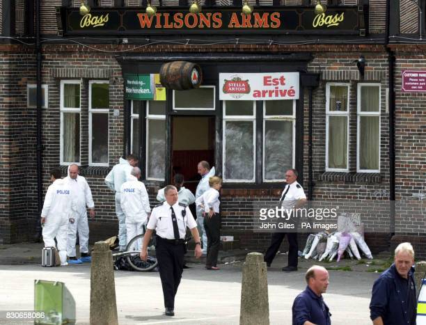 Police officers search at the Wilsons Arms Pub Leeds where a fatherofone was gunned down while children played party games Former professional Rugby...