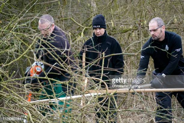 Police officers search dense undergrowth in Oak Road Park in Hull near to the home of missing 21yearold student Libby Squire on February 13 2019 in...