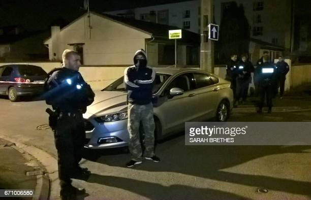 Police officers search near the house of the suspected attacker who opened fire on police on Paris' Champs Elysees, in Chelles on April 21, 2017. A...