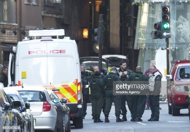 Police officers search the area around London Bridge central London following last night incident where six people were killed in a terror attack in...