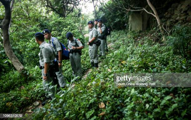 Police officers search the area near Repulse Bay Road as the residence of New World Development founder Cheng Yutung was burgled yesterday 09AUG16...