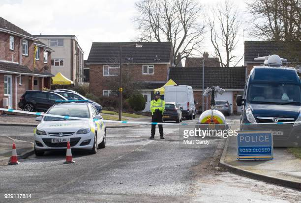 Police officers search the home of Sergei Skripal in Salisbury who was found critically ill on a bench with his daughter on March 4 and were taken to...