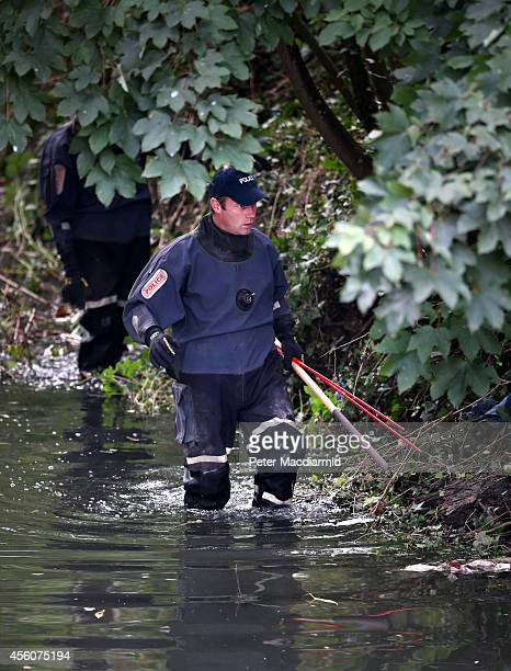 Police officers search the river Brent for clues in the hunt for schoolgirl Alice Gross on September 25 2014 in London England The hunt for Alice...
