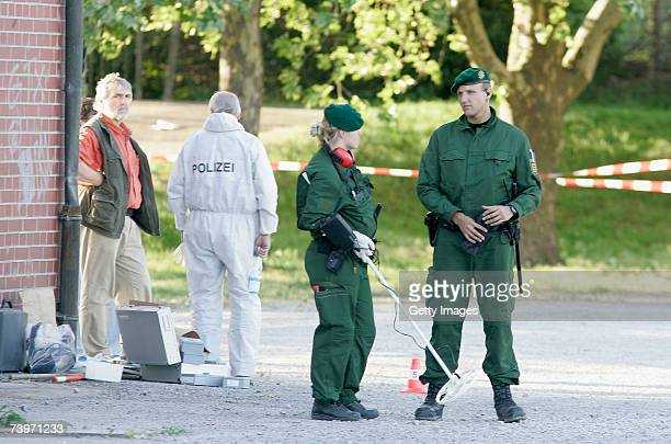 Police officers search the scene where two police officers were shot at the Theresienwiese on April 25 2007 in Heilbronn Germany Pedestrians found a...