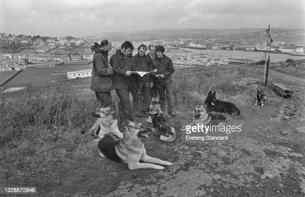 Police officers searching the hills above Newhaven, after a car belonging to John Bingham, the 7th Earl of Lucan, was found abandoned there, UK,...