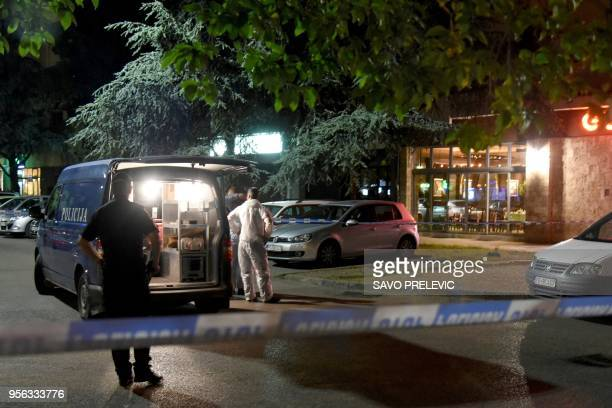 Police officers secure a crime scene after an attacker shot an investigative reporter in Montenegro's capital Podgorica on May 8 2018 An attacker...