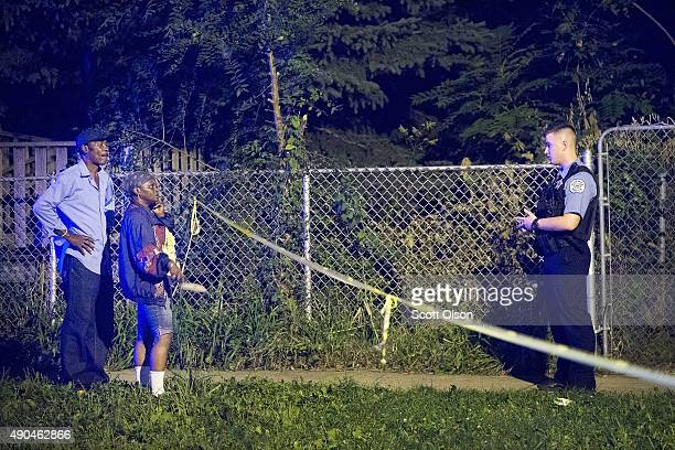 Police officers secure a shooting scene where 5 people were reported to have been shot including an 11monthold infant on September 28 2015 in Chicago...