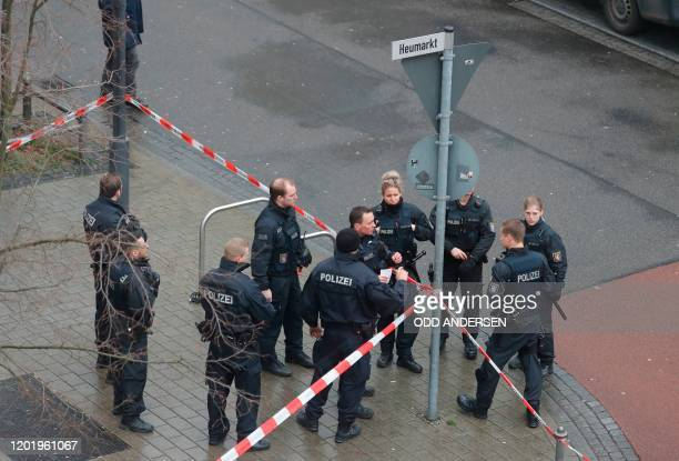 Police officers secure a street near one of the bar target in a shooting at the Heumarkt in the centre of Hanau near Frankfurt am Main western...