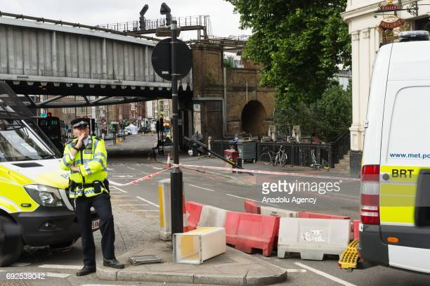 Police officers secure area outside The Barrowboy and Banker pub tavern south of London Bridge in London England on June 05 2017 This follows the...