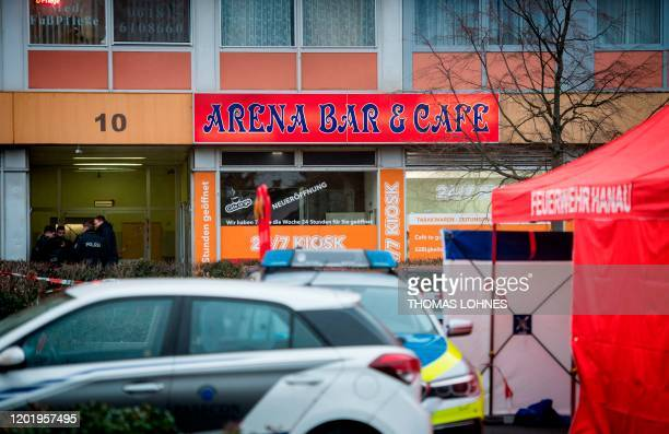 Police officers secure one of the bar target in a shooting in Kesselstadt near Frankfurt western Germany on February 20 2020 The suspect in two...